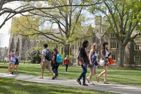 students walking across West campus