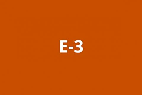 E-3 on a dark red-orange background