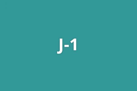 J-1 on teal background
